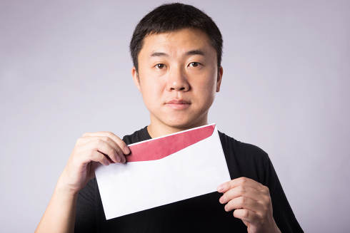 Man with open envelope | Collection Agency, Collection Laws, Statutes of Limitation