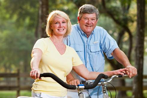 Couple on Bicycles | Reverse Mortgage Qualifications