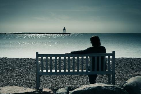 Person Alone On Bench Overlooking the Sea | Dealing with deceased person\'s debt