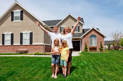 Bad Credit Home Loan: Happy family in front of their house