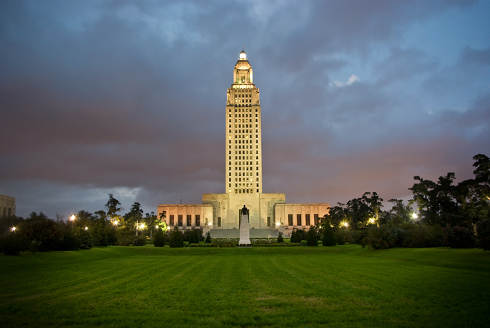 Louisiana Collection Laws | Louisiana Capitol at dusk