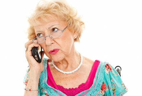 Negotiate Medical Bills | Woman talks on telephone